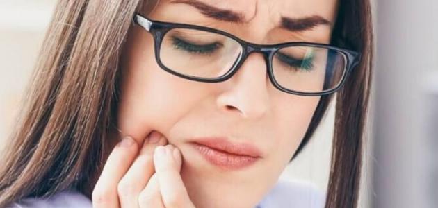 ماهي اعراض الم ضرس العقل